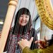 Girl smiling with harp